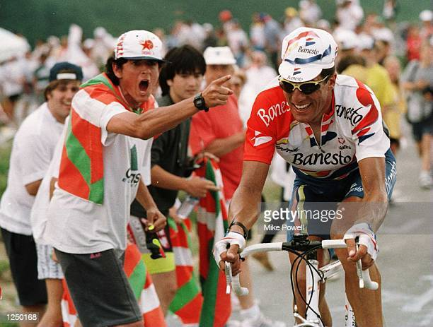 Miguel Indurain of Spain and Team Banesto being urged on by a Spanish fan as he lost a further 2 Min 38 secs to Bjarne Riis's overall lead Stage...