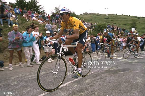 Miguel Indurain of Spain and team Banesto is pursued by Luc Leblanc on Stage 16 of the Tour de France between Valreas and LAlpe d''Huez in France...