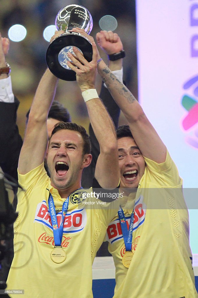 Miguel Layun and Rubens Sambueza of America celebrates the victory and championship after a Final second leg match between America and Tigres UANL as part of the Apertura 2014 Liga MX at Azteca Stadium on December 14, 2014 in Mexico City, Mexico.