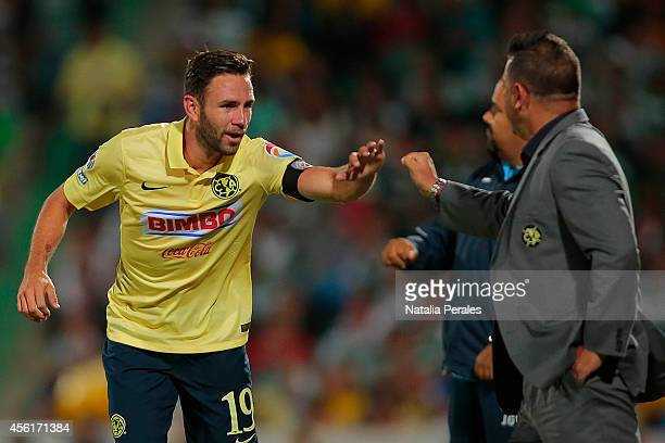 Miguel Layun celebrates after scoring his third goal of the game during a match between Santos Laguna and America as part of 10th round Apertura 2014...