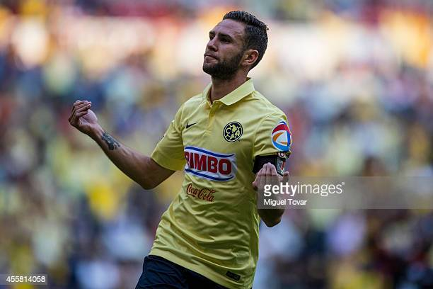 Miguel Layun of America celebrates after scoring the winning goal during a match between America and Pachuca as part of 9th round Apertura 2014 Liga...