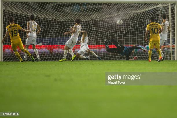 Miguel Layun of America scores a goal against Pumas during a match between Pumas and America as part of the Apertura 2013 Liga MX at Olympic stadium...
