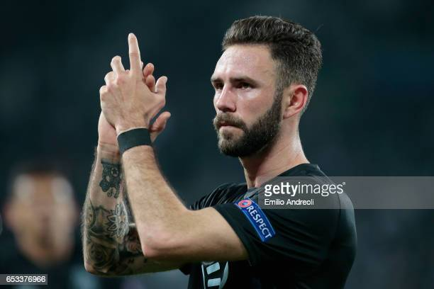 Miguel Layun of FC Porto greets the fans at the end of the UEFA Champions League Round of 16 second leg match between Juventus and FC Porto at...