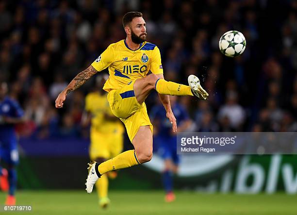 Miguel Layun of FC Porto jumps for the ball during the UEFA Champions League Group G match between Leicester City FC and FC Porto at The King Power...