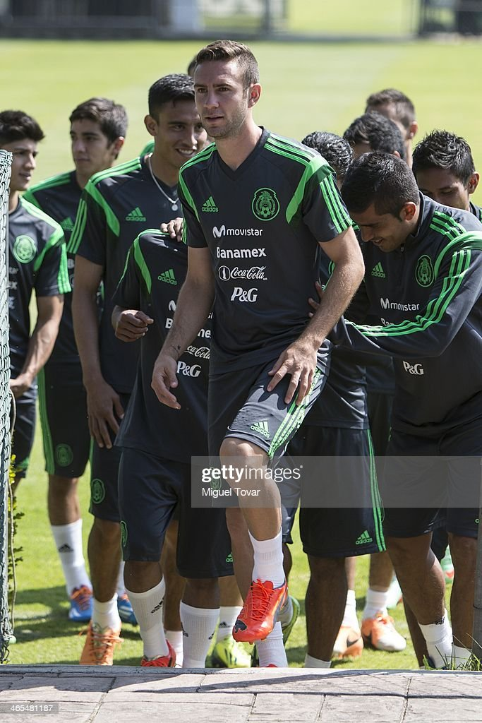 Miguel Layun of Mexican National soccer team leaves the field with teammates after a training session at CAR on January 27, 2014 in Mexico City, Mexico. The team is preparing to face Korea in a friendly match.