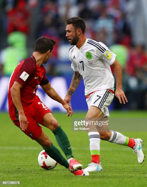 Miguel Layun of Mexico attempts to take the ball past Cedric of Portugal during the FIFA Confederations Cup Russia 2017 Group A match between...