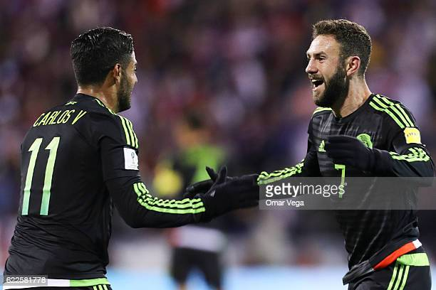 Miguel Layun of Mexico celebrates with teammate Carlos Vela after scoring his team's first goal during the match between USA and Mexico as part of...