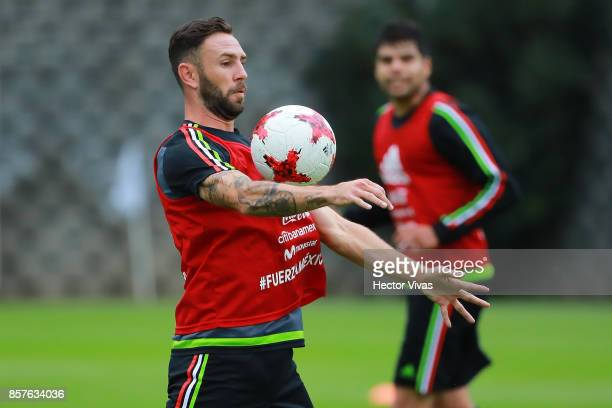 Miguel Layun of Mexico controls the ball during a Mexico's National Team training session ahead of the Qualifier match against Trinidad Tobago at CAR...