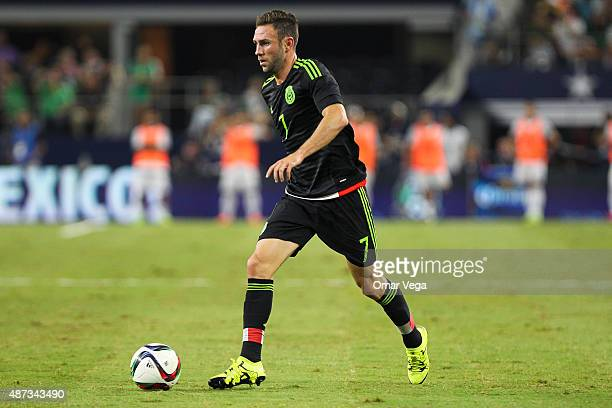 Miguel Layun of Mexico drives the ball during a friendly match between Argentina and Mexico at ATT Stadium on September 08 2015 in Arlington United...