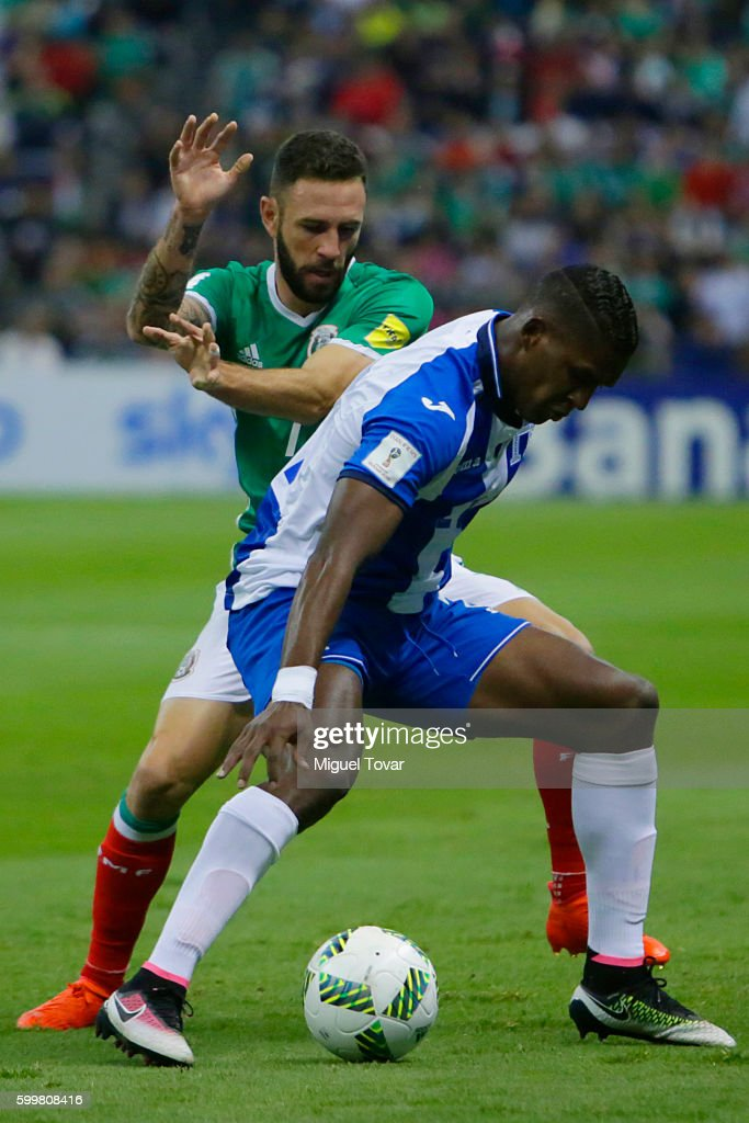 Miguel Layun of Mexico fights for the ball with Donis Escober of Honduras during a match between Mexico and Honduras as part of FIFA 2018 World Cup Qualifiers at Azteca Stadium on September 06, 2016 in Mexico City, Mexico.