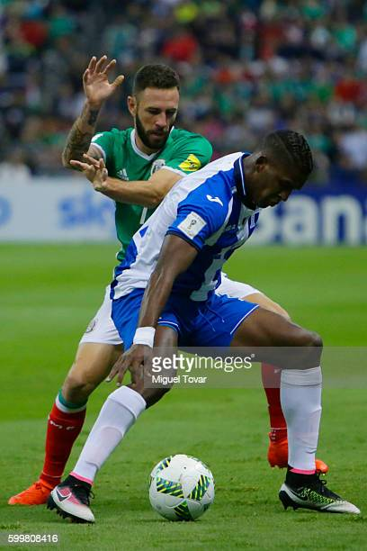 Miguel Layun of Mexico fights for the ball with Donis Escober of Honduras during a match between Mexico and Honduras as part of FIFA 2018 World Cup...