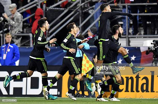 Miguel Layun of Mexico is swarmed by his teammates after scoring a goal in the first half against the United States during the FIFA 2018 World Cup...