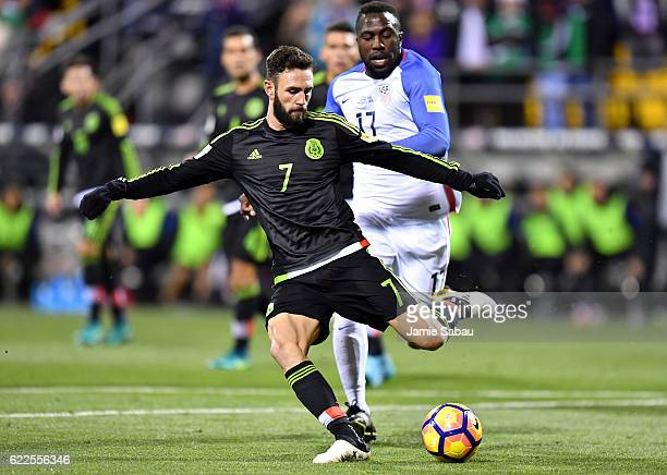 Miguel Layun of Mexico kicks the ball while Jozy Altidore of the United States defends in the first half during the FIFA 2018 World Cup Qualifier at...