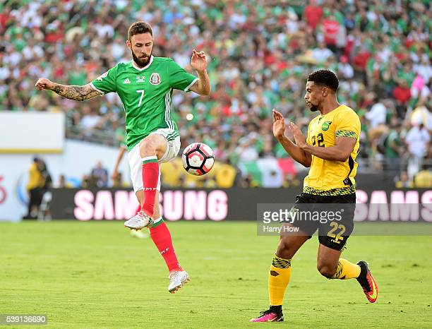 Miguel Layun of Mexico takes a pass in front of Garath McCleary of Jamaica during Copa America Centenario at Rose Bowl on June 9 2016 in Pasadena...