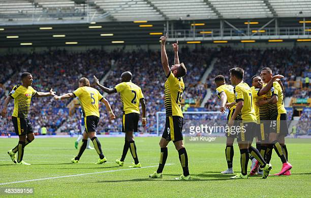 Miguel Layun of Watford celebrates scoring his team's first goal with his team mates during the Barclays Premier League match between Everton and...