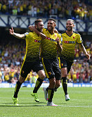 Miguel Layun of Watford celebrates scoring his team's first goal with his team mate Etienne Capoue during the Barclays Premier League match between...