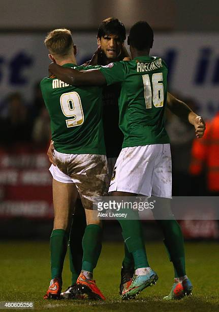 Miguel Llera of Scunthorpe United celebrates with team mates after scoring the winning penalty in a 1314 shoot out during the FA Cup Second Round...