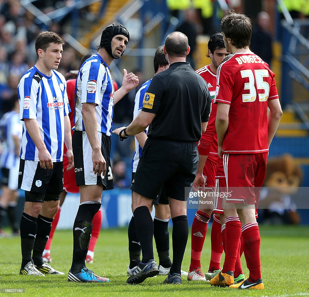 S Miguel Llera of Sheffield Wednesday makes a point to referee Andy Haines during the npower Championship match between Sheffield Wednesday and Middlesbrough at Hillsborough Stadium on May 4, 2013 in Sheffield, England.