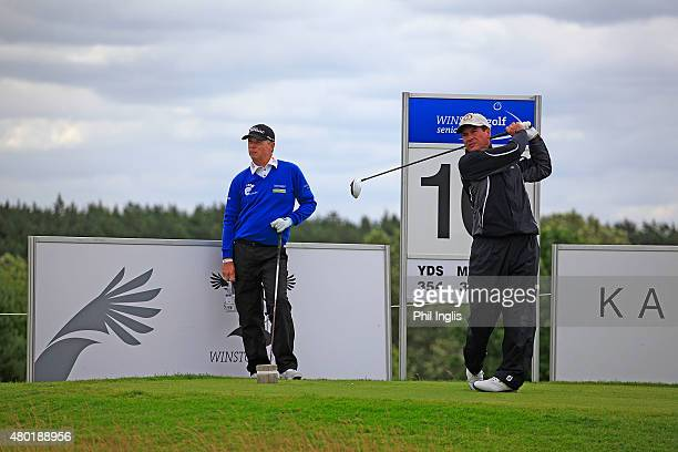 Miguel Martin of Spain watched by Gary Wolstenholme of England in action during the first round of the Winston Senior Open played at WinstonGolf on...