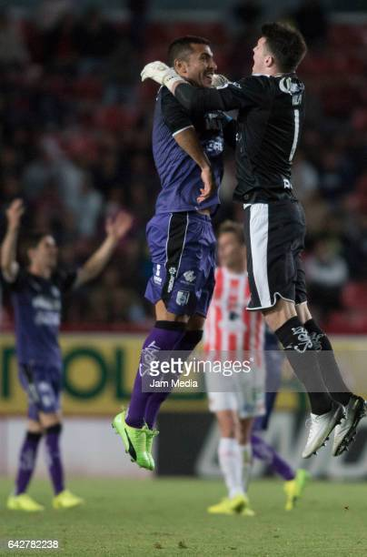 Miguel Martinez and Tiago Volpi of Queretaro celebrate during the 7th round match between Necaxa and Queretaro as part of the Torneo Clausura 2017...