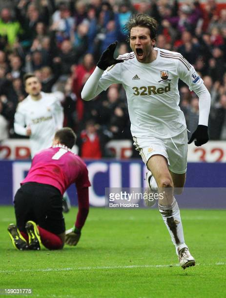 Miguel Michu of Swansea City celebrates as he scores their first goal during the FA Cup with Budweiser Third Round match between Swansea City and...