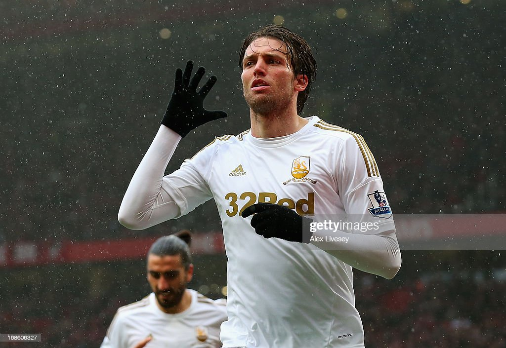 Miguel <a gi-track='captionPersonalityLinkClicked' href=/galleries/search?phrase=Michu+-+Soccer+Player&family=editorial&specificpeople=9691137 ng-click='$event.stopPropagation()'>Michu</a> of Swansea City celebrates scoring his team's first goal to make the score 1-1 during the Barclays Premier League match between Manchester United and Swansea City at Old Trafford on May 12, 2013 in Manchester, England.