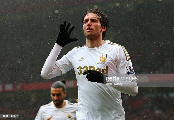 Miguel Michu of Swansea City celebrates scoring his team's first goal to make the score 11 during the Barclays Premier League match between...