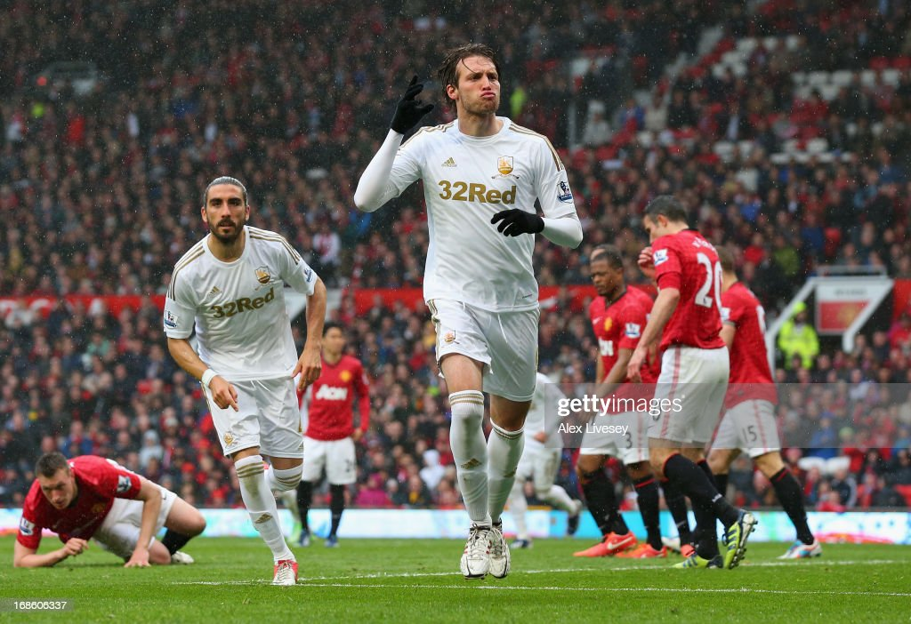 Miguel <a gi-track='captionPersonalityLinkClicked' href=/galleries/search?phrase=Michu+-+Futbolista&family=editorial&specificpeople=9691137 ng-click='$event.stopPropagation()'>Michu</a> of Swansea City celebrates scoring his team's first goal to make the score 1-1 during the Barclays Premier League match between Manchester United and Swansea City at Old Trafford on May 12, 2013 in Manchester, England.