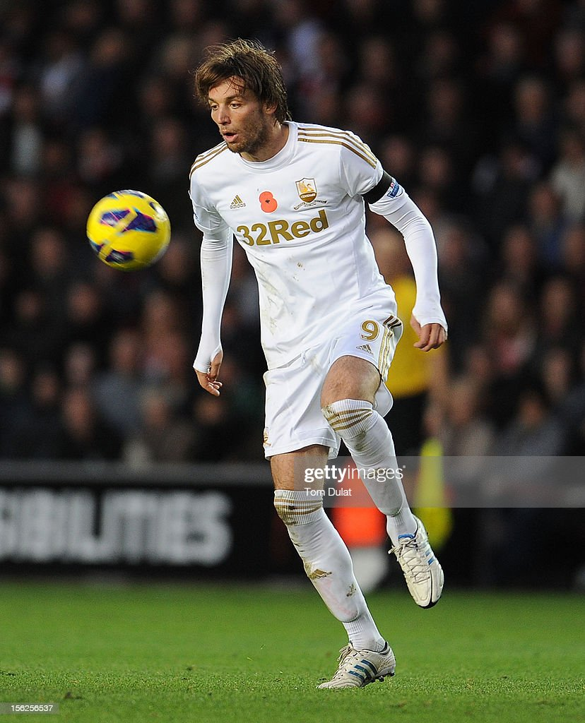 Miguel <a gi-track='captionPersonalityLinkClicked' href=/galleries/search?phrase=Michu+-+Voetballer&family=editorial&specificpeople=9691137 ng-click='$event.stopPropagation()'>Michu</a> of Swansea City during the Barclays Premier League match between Southampton and Swansea City at St Mary's Stadium on November 10, 2012 in Southampton, England.