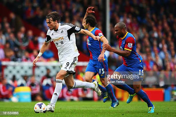 Miguel Michu of Swansea City evades Danny Gabbidon of Crystal Palace during the Barclays Premier League match between Crystal Palace and Swansea City...