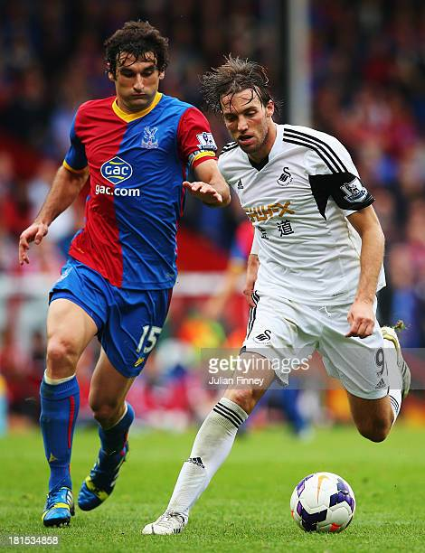 Miguel Michu of Swansea City holds off Mile Jedinak of Crystal Palace during the Barclays Premier League match between Crystal Palace and Swansea...