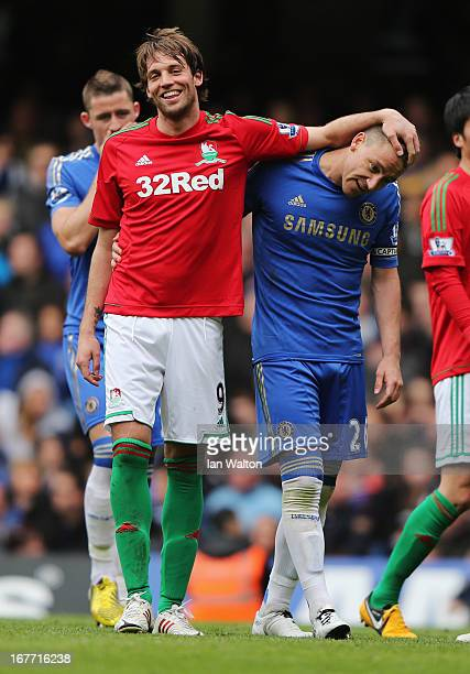 Miguel Michu of Swansea City jokes with John Terry of Chelsea during the Barclays Premier League match between Chelsea and Swansea City at Stamford...