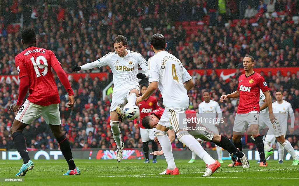 Miguel <a gi-track='captionPersonalityLinkClicked' href=/galleries/search?phrase=Michu+-+Soccer+Player&family=editorial&specificpeople=9691137 ng-click='$event.stopPropagation()'>Michu</a> of Swansea City scores his team's first goal to make the score 1-1 during the Barclays Premier League match between Manchester United and Swansea City at Old Trafford on May 12, 2013 in Manchester, England.