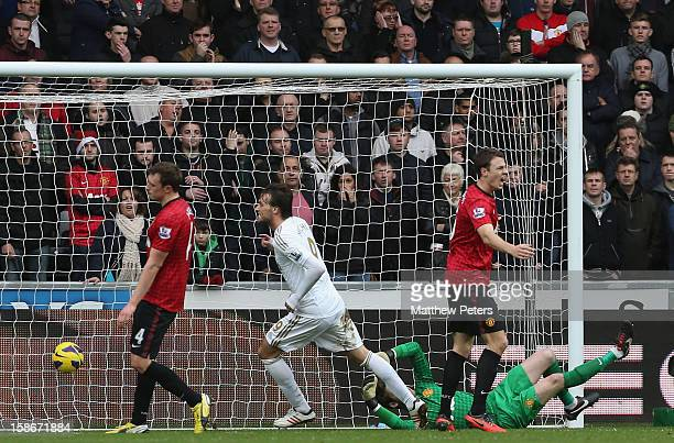 Miguel Michu of Swansea City scores their first goal during the Barclays Premier League match between Swansea City and Manchester United at Liberty...
