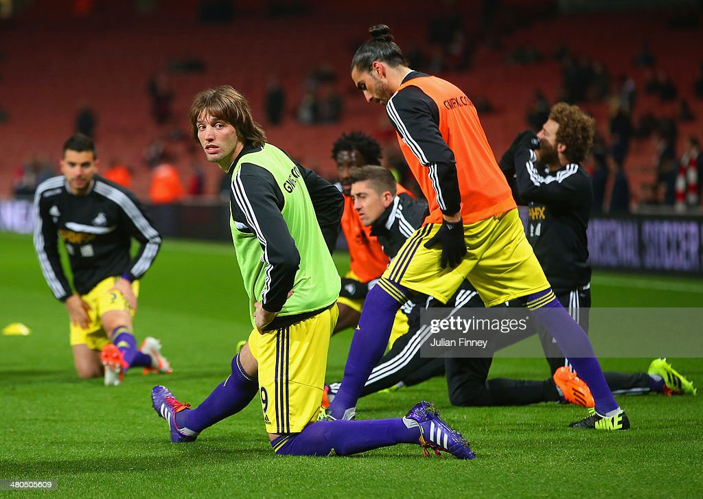 Miguel Michu of Swansea City stretches ahead of the Barclays Premier League match between Arsenal and Swansea City at Emirates Stadium on March 25, 2014 in London, England.