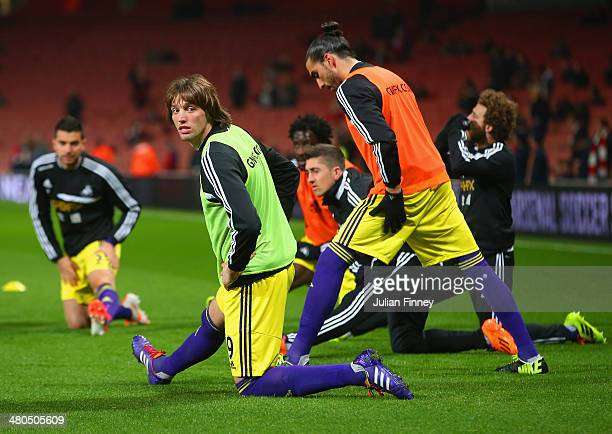 Miguel Michu of Swansea City stretches ahead of the Barclays Premier League match between Arsenal and Swansea City at Emirates Stadium on March 25...