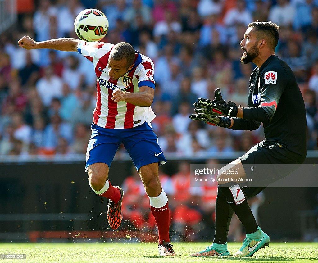 Miguel Miranda of Atletico de Madrid scores on his goal during the La Liga match between Valencia CF and Club Atletico de Madrid at Estadi de...