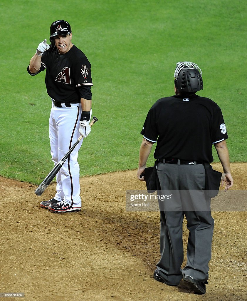 Miguel Montero #26 of the Arizona Diamondbacks argues with Home Plate Umpire Gary Cederstrom #38 after being called out on strikes in the eighth inning against the Philadelphia Phillies at Chase Field on May 11, 2013 in Phoenix, Arizona.