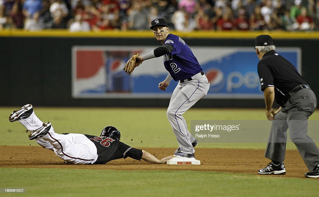 <a gi-track='captionPersonalityLinkClicked' href=/galleries/search?phrase=Miguel+Montero&family=editorial&specificpeople=836495 ng-click='$event.stopPropagation()'>Miguel Montero</a> #26 of the Arizona Diamondbacks gets doubled up by <a gi-track='captionPersonalityLinkClicked' href=/galleries/search?phrase=Troy+Tulowitzki&family=editorial&specificpeople=757353 ng-click='$event.stopPropagation()'>Troy Tulowitzki</a> #2 of the Colorado Rockies on a line drive to the pitcher during the fourth inning of a MLB game at Chase Field on September 14, 2013 in Phoenix, Arizona.