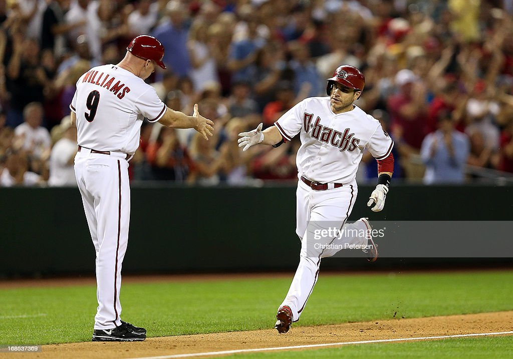 <a gi-track='captionPersonalityLinkClicked' href=/galleries/search?phrase=Miguel+Montero&family=editorial&specificpeople=836495 ng-click='$event.stopPropagation()'>Miguel Montero</a> #26 of the Arizona Diamondbacks high-fives third base coach <a gi-track='captionPersonalityLinkClicked' href=/galleries/search?phrase=Matt+Williams+-+Baseball+Manager&family=editorial&specificpeople=11566291 ng-click='$event.stopPropagation()'>Matt Williams</a> #9 after hitting a solo home run against the Philadelphia Phillies during the eighth inning of the MLB game at Chase Field on May 10, 2013 in Phoenix, Arizona. The Diamondbacks defeated the Phillies 3-2.