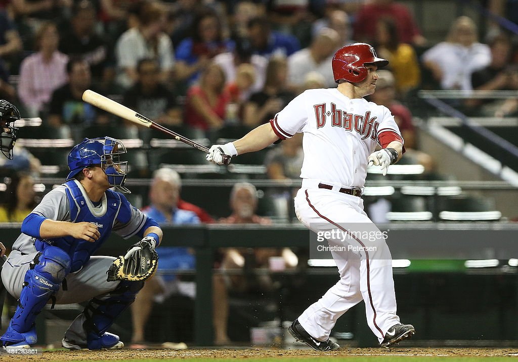 <a gi-track='captionPersonalityLinkClicked' href=/galleries/search?phrase=Miguel+Montero&family=editorial&specificpeople=836495 ng-click='$event.stopPropagation()'>Miguel Montero</a> #26 of the Arizona Diamondbacks hits a single against the Los Angeles Dodgers during the sixth inning of the MLB game at Chase Field on April 11, 2014 in Phoenix, Arizona. The Dodgers defeated the Diamondbacks 6-0.