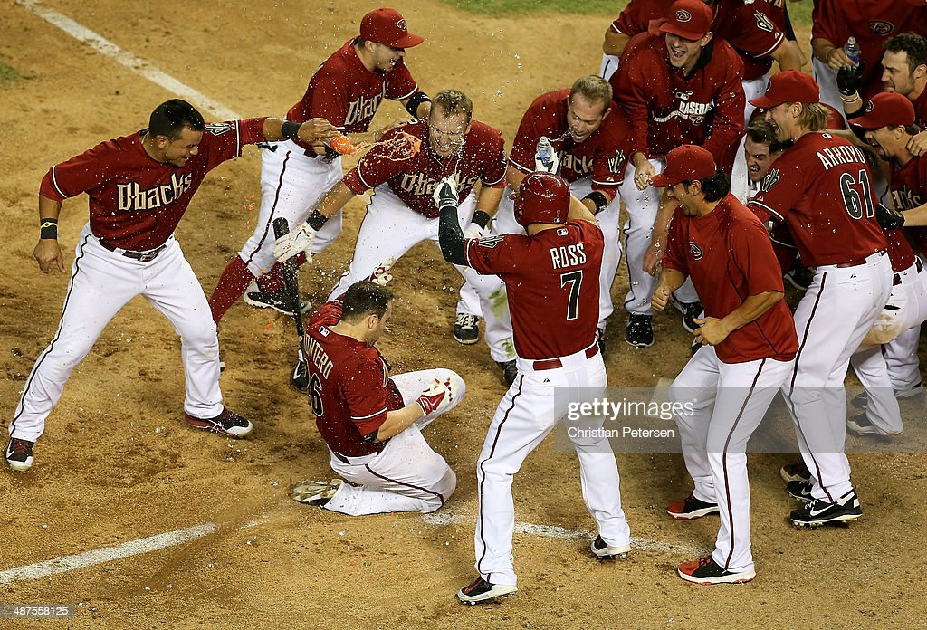 Miguel Montero of the Arizona Diamondbacks is congratulated by teammates after hitting a walk off solo home run against the Colorado Rockies in the...