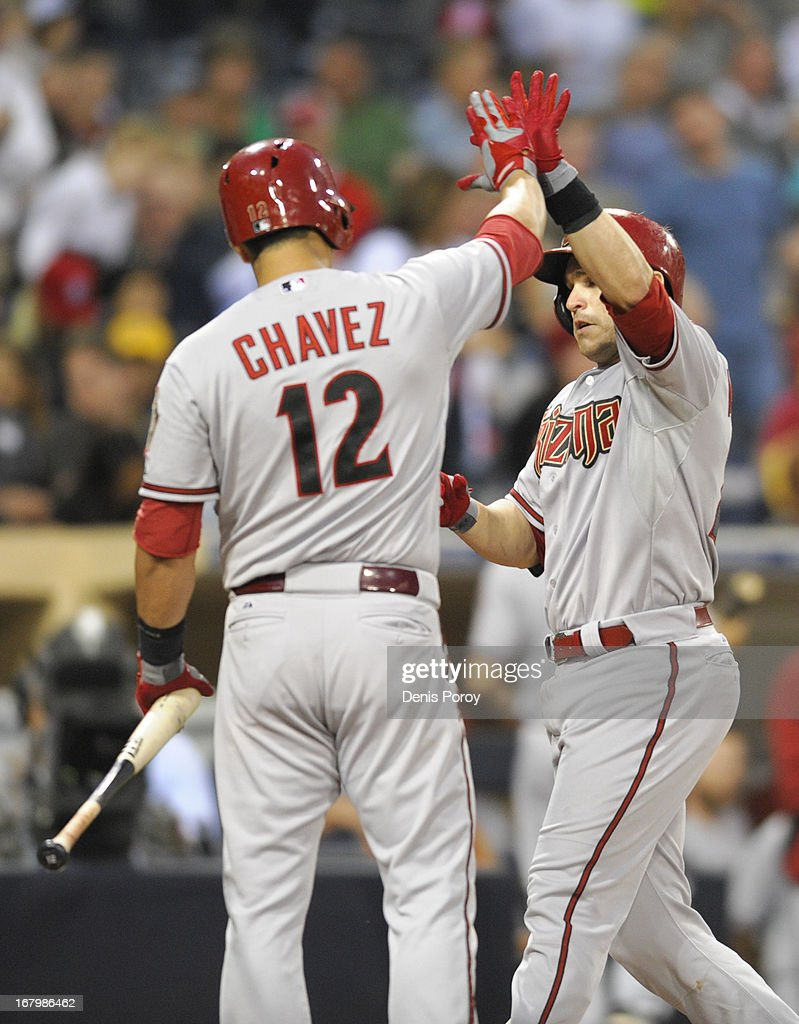 <a gi-track='captionPersonalityLinkClicked' href=/galleries/search?phrase=Miguel+Montero&family=editorial&specificpeople=836495 ng-click='$event.stopPropagation()'>Miguel Montero</a> #26 of the Arizona Diamondbacks is congratulated by <a gi-track='captionPersonalityLinkClicked' href=/galleries/search?phrase=Eric+Chavez&family=editorial&specificpeople=201561 ng-click='$event.stopPropagation()'>Eric Chavez</a> #12 after hitting a solo home run in the second inning of a baseball game against the San Diego Padres at Petco Park on May 3, 2013 in San Diego, California.