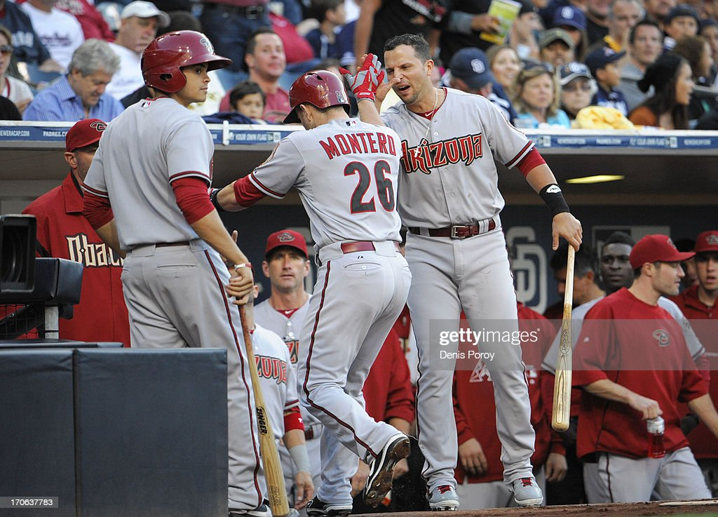 <a gi-track='captionPersonalityLinkClicked' href=/galleries/search?phrase=Miguel+Montero&family=editorial&specificpeople=836495 ng-click='$event.stopPropagation()'>Miguel Montero</a> #26 of the Arizona Diamondbacks is welcomed into the dugout after hitting a two-run homer in the first inning of a baseball game against the San Diego Padres at Petco Park on June 15, 2013 in San Diego, California.