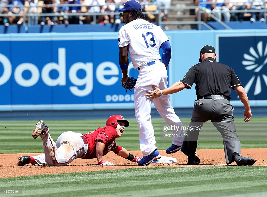 <a gi-track='captionPersonalityLinkClicked' href=/galleries/search?phrase=Miguel+Montero&family=editorial&specificpeople=836495 ng-click='$event.stopPropagation()'>Miguel Montero</a> #26 of the Arizona Diamondbacks reacts after being called out trying to stretch a double by second base umpire Scott Barry after being tagged by shortstop <a gi-track='captionPersonalityLinkClicked' href=/galleries/search?phrase=Hanley+Ramirez&family=editorial&specificpeople=538406 ng-click='$event.stopPropagation()'>Hanley Ramirez</a> #13 of the Los Angeles Dodgers in the second inning at Dodger Stadium on April 20, 2014 in Los Angeles, California.