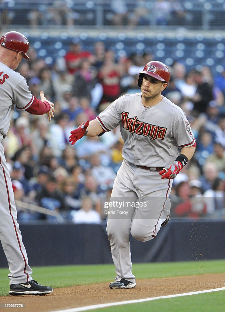 <a gi-track='captionPersonalityLinkClicked' href=/galleries/search?phrase=Miguel+Montero&family=editorial&specificpeople=836495 ng-click='$event.stopPropagation()'>Miguel Montero</a> #26 of the Arizona Diamondbacks, right, is congratulated by Matt Williams #9 after hitting a two-run homer in the first inning of a baseball game against the San Diego Padres at Petco Park on June 15, 2013 in San Diego, California.
