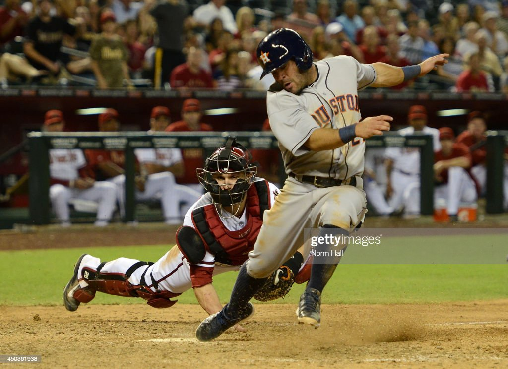 Miguel Montero of the Arizona Diamondbacks tags out Jose Altuve of the Houston Astros at home plate during the ninth inning at Chase Field on June 9...