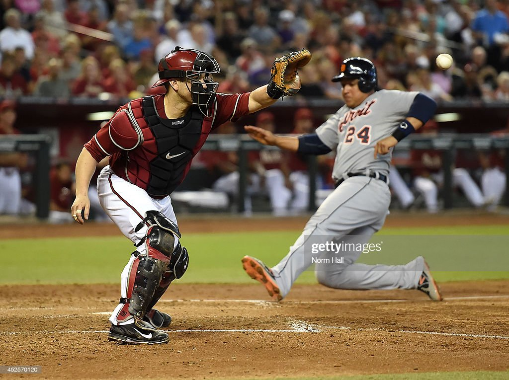 <a gi-track='captionPersonalityLinkClicked' href=/galleries/search?phrase=Miguel+Montero&family=editorial&specificpeople=836495 ng-click='$event.stopPropagation()'>Miguel Montero</a> #26 of the Arizona Diamondbacks waits for a throw as <a gi-track='captionPersonalityLinkClicked' href=/galleries/search?phrase=Miguel+Cabrera&family=editorial&specificpeople=202141 ng-click='$event.stopPropagation()'>Miguel Cabrera</a> #24 of the Detroit Tigers slides safely into home during the fourth inning at Chase Field on July 23, 2014 in Phoenix, Arizona.