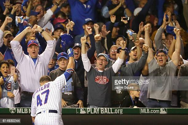 Miguel Montero of the Chicago Cubs celebrates hitting a grand slam home run in the eighth inning against the Los Angeles Dodgers during game one of...
