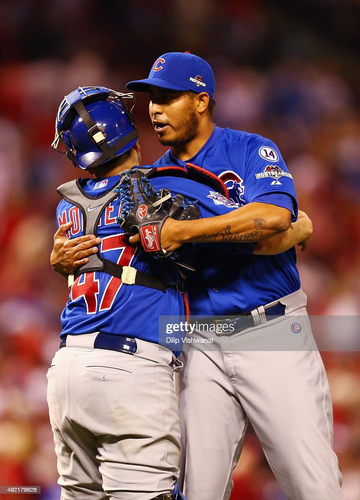 Miguel Montero #47 of the Chicago Cubs celebrates with Hector Rondon #56 of the Chicago Cubs after the Chicago Cubs defeat the St. Louis Cardinals in game two of the National League Division Series at Busch Stadium on October 10, 2015 in St Louis, Missouri. The Chicago Cubs defeat the St. Louis Cardinals with a score of 6 to 3.